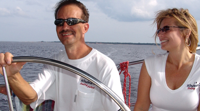 Captain Tony Jones and his wife on a Sailboat
